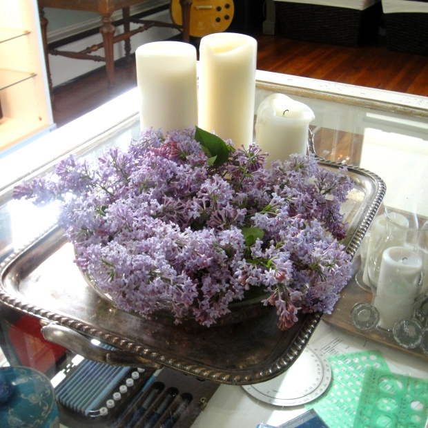 Low centerpiece of lilacs on a silver tray