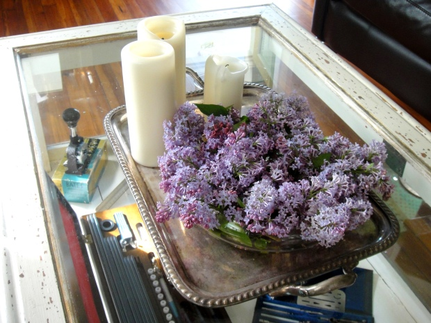 Low centerpiece of lilacs and candles