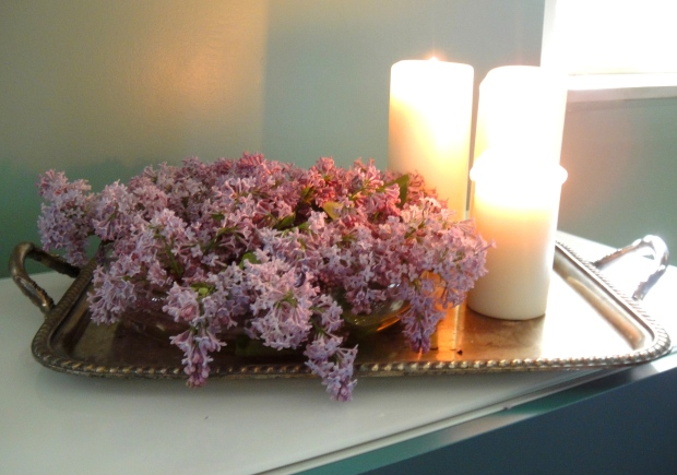 A tray of lilacs and candles