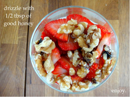 Healthy parfait topped with honey