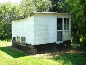 Side of chicken coop with door