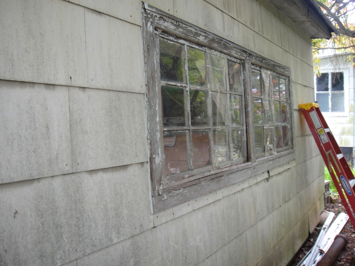 Broken windows in need of glazing